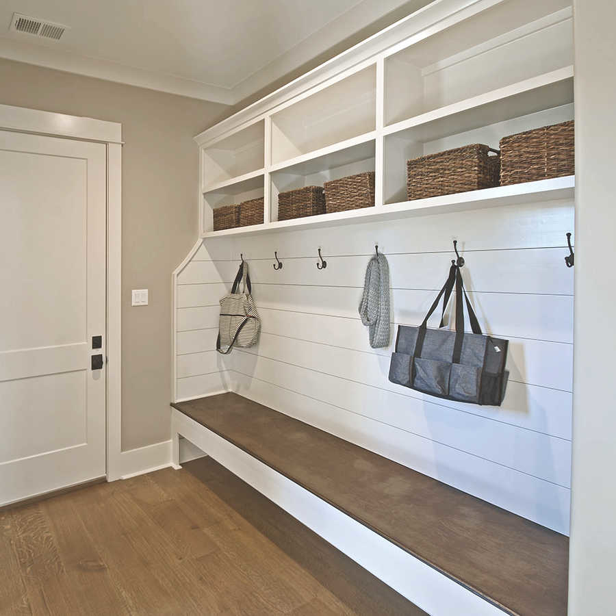 Door from garage enters into spacious mudroom with ample storage for coats, shoes and bags