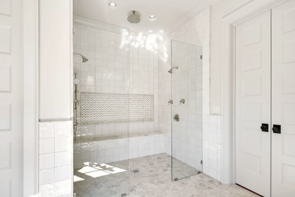 Master shower with dual shower heads and tile up to ceiling